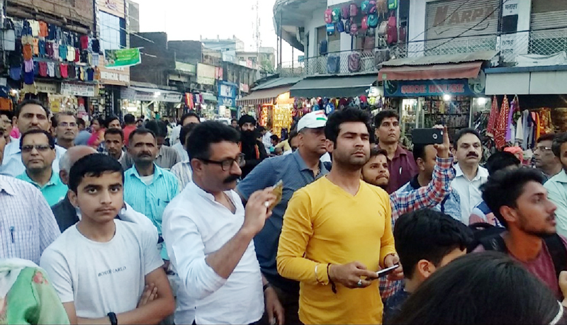 Civil society taking out candle march in Udhampur.