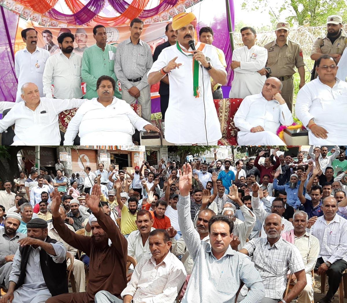 Congress candidate Vikramaditya Singh addressing an election rally in Hiranagar.