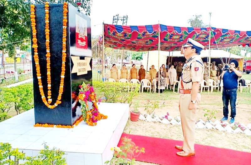 DG Fire and Emergency Services, V K Singh saluting before the martyrs memorial during commemoration of National Fire Services Day at Jammu on Sunday.
