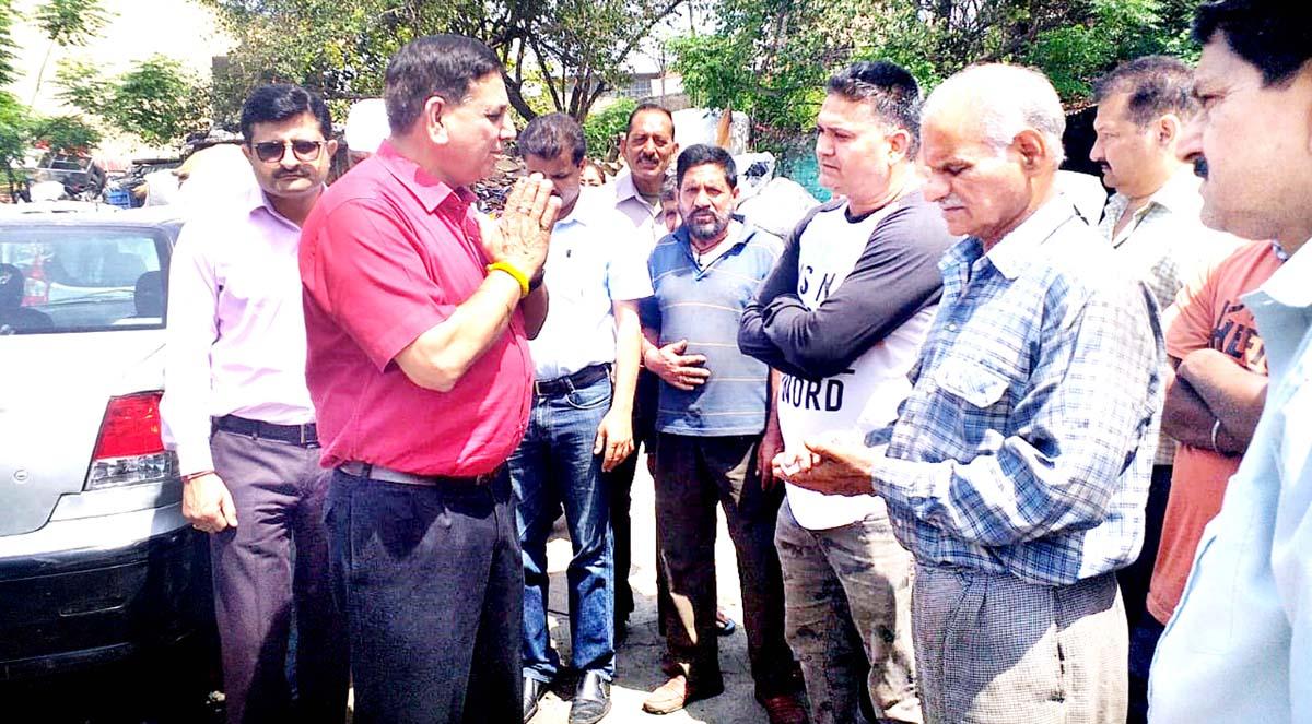 JMC Mayor interacting with shopkeepers at Municipal Market Parade, Jammu.