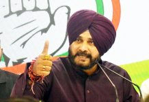 Congress leader and Punjab Cabinet Minister Navjot Singh Sidhu addressing a press conference at AICC headquarters in New Delhi on Saturday. (UNI)
