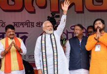 Prime Minister Narendra Modi waves at the supporters during an election campaign rally in support of the BJP candidates, ahead of the Lok Sabha elections at Rash Mela Ground in Cooch Behar district of West Bengal on Sunday.