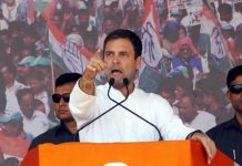 Congress President Rahul Gandhi addressing an election rally at P.M. Ground, Bajipura, District Tapi, in Gujarat on Friday. (UNI)
