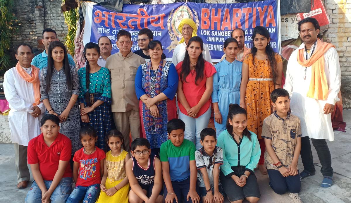 Bhartiya Lok Sangeet Kala Sansthan artists posing for a group photograph after making a performance at Jammu on Saturday.