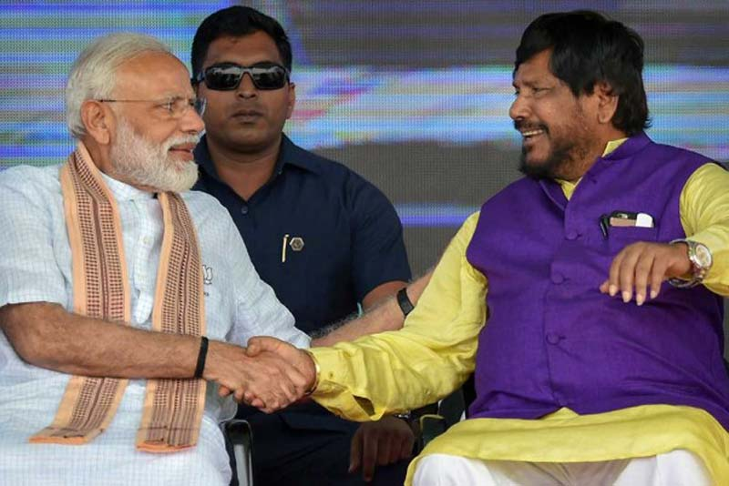 Prime Minister Narendra Modi shakes hands with Union Social Justice Minister and Republican Party of India(A) president, Ramdas Athawale, during a rally ahead of the Lok Sabha elections, at Akluj, in Solapur district.