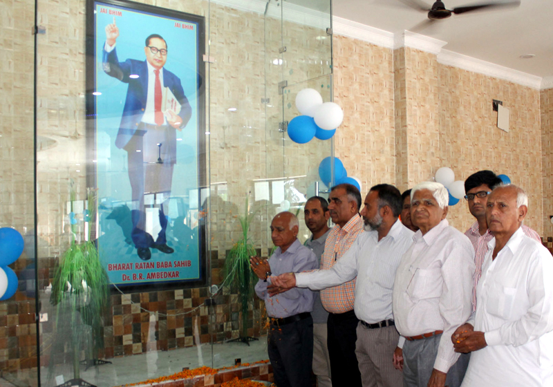 People paying tributes to Dr Bhim Rao Ambedkar in a function held at Guru Ravi Dass Sabha in Jammu on Sunday. -Excelsior/Rakesh