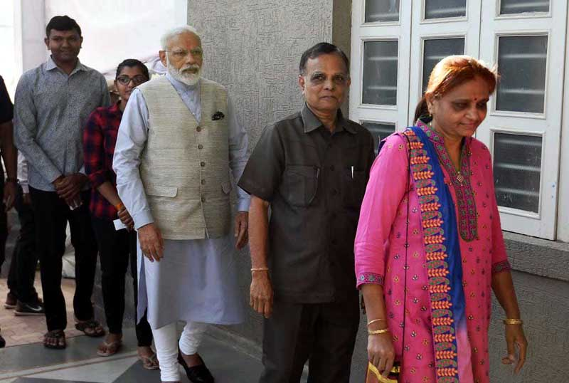 PM Modi caste his vote in queue in Ahmedabad on Tuesday.