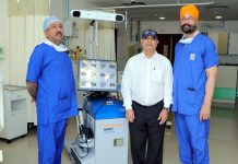 Dr Avtar Singh and Dr Suresh Singla posing with a patient on whom they performed robotic knee replacement surgery.