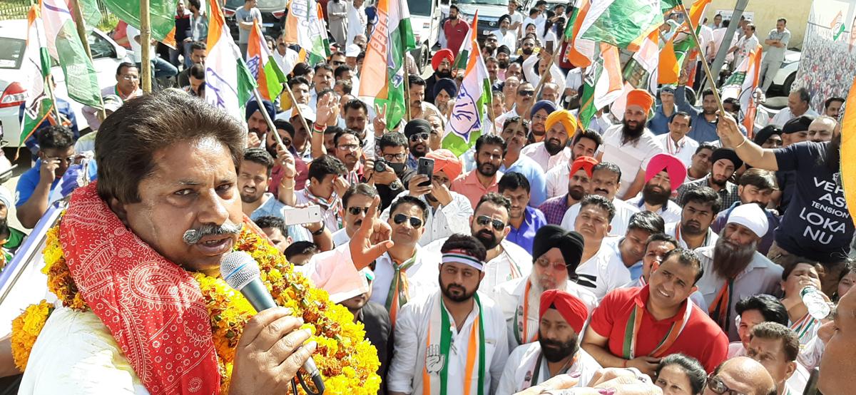Senior Congress leader Raman Bhalla addressing a public meeting in Gandhi Nagar on Tuesday.