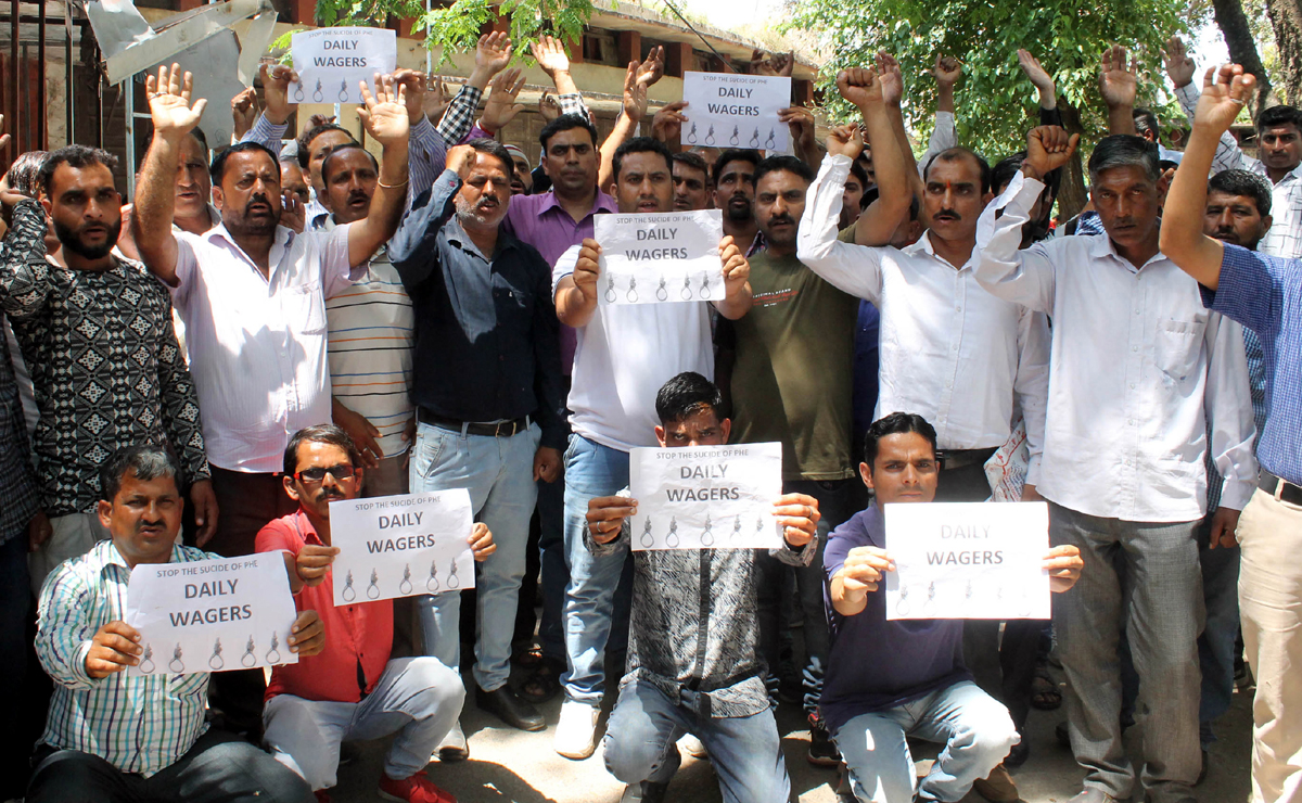 PHE daily wagers staging protest near Press Club in Jammu on Monday. -Excelsior/ Rakesh