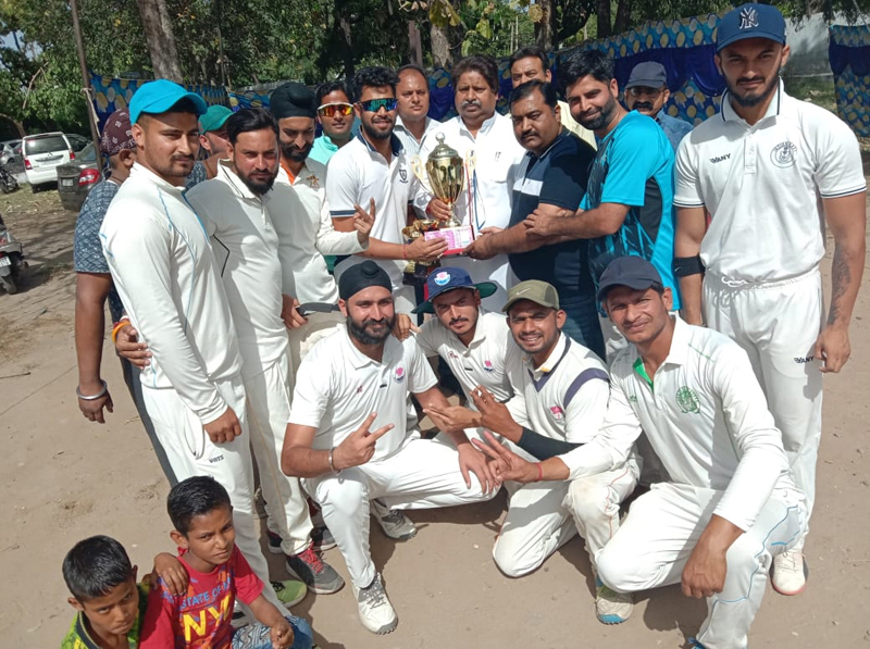 Players of Horizon Cricket Club posing along with former Minister Raman Bhalla after winning the title in Jammu.