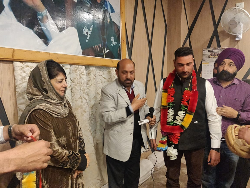 PDP president, Mehbooba Mufti welcoming BJP and Congress leaders into party fold at a function in Srinagar.