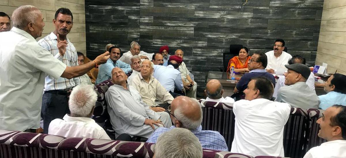 Corporator, Ward No 42, Vijay Choudhary along with former Mayor, Choudhary Manmohan Singh, hearing people's problems in Nanak Nagar, Jammu.