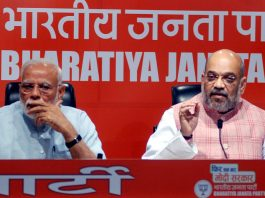 Prime Minister Narendra Modi with BJP national president Amit Shah addressing a press conference at BJP headquarters, in New Delhi on Friday. (UNI)
