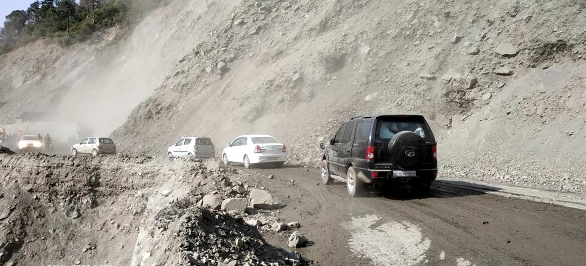 Vehicles moving towards Kashmir again stranded after fresh landslides at Digdol on Friday evening. -Excelsior/Parvaiz Mir