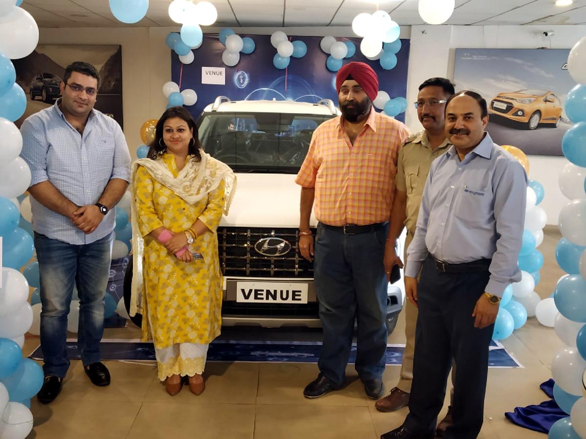 ARTO Udhampur Rachna Sharma along with others unveiling Hyundai Venue at Devika Hyundai Udhampur.