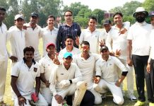 Players of Spartan Cricket Club posing for a group photograph after their win in JKCA Jammu District Tournament at GGM Science College ground in Jammu.