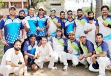 Players posing for a group photograph after an exhibition match between JU and Media XI on Sunday.