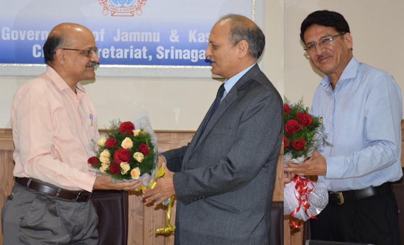 Chief Secretary BVR Subrahmanyam presenting bouquet to Suresh Kumar and Anil Kumar Gupta in a farewell function on Thursday.