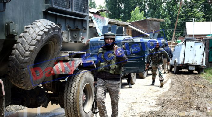 Security forces at the encounter site at Panzgam in Awantipora on Saturday. —Excelsior/Younis Khaliq