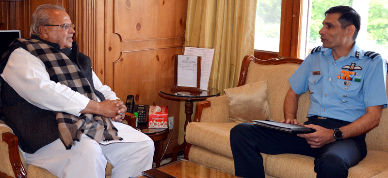 Governor Satya Pal Malik meeting Air Vice Marshal Pankaj Mohan Sinha on Saturday.