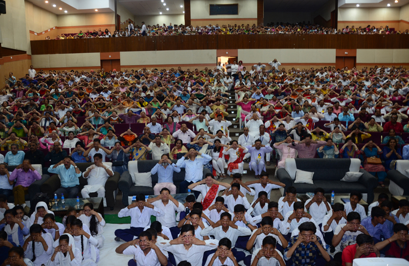 Participants during a special yoga programme at Jammu on Saturday.