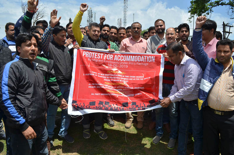 PM package employees protesting at Srinagar on Saturday. —Excelsior/Shakeel