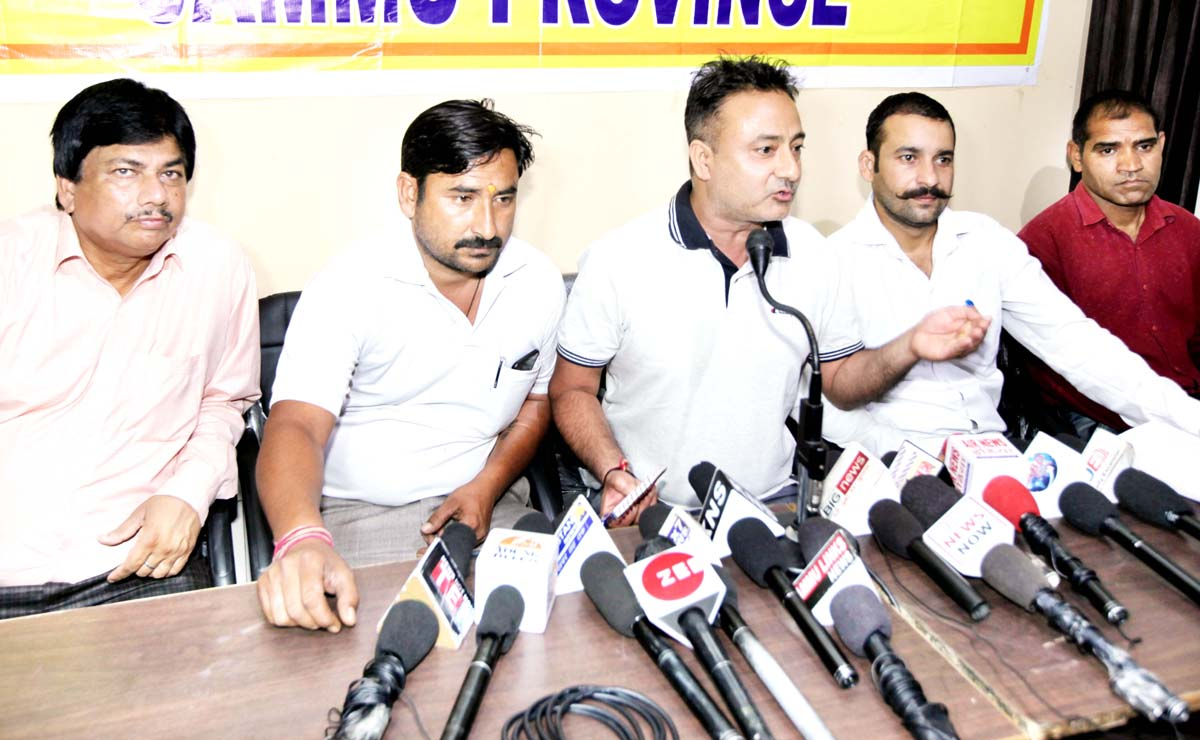 PHE Employees United Front leader Navdeep Singh and others at a press conference in Jammu on Friday. -Excelsior/Rakesh