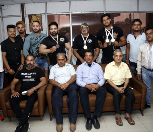 Medal winners of Strength Lifting Association posing along with dignitaries during felicitation function in Jammu.