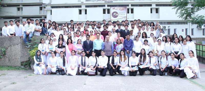 Law students posing with faculty members and guests during a workshop at JU.
