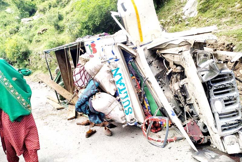 Tata Mobile vehicle which turned turtle on Mughal Road near Bafliaz. -Excelsior/Ramesh Bali
