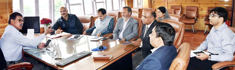 Advisor Vijay Kumar chairing a meeting at Srinagar on Monday.