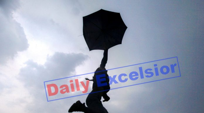 Girl enjoys cloudy weather as rains bring temperature down in Jammu on Monday evening, giving some relief to Jammuites from the scorching heat. -Excelsior/Rakesh