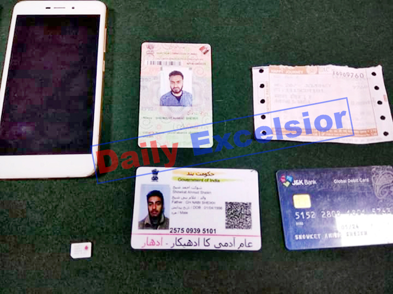 Identity cards, ATM and mobile phone recovered from the militants. -Excelsior/Parvaiz