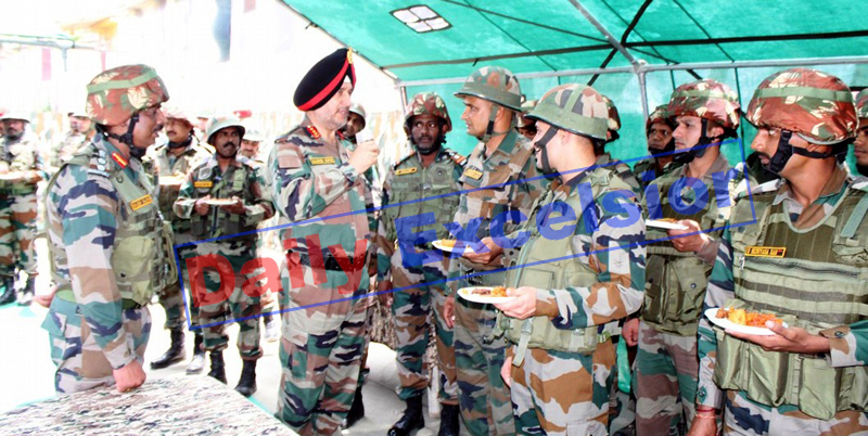 Northern Command chief Lt Gen Ranbir Singh with the troops on LoC on Monday.