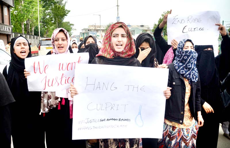 Students staging a protest over Sumbal rape case in Srinagar on Monday. -Excelsior/Shakeel