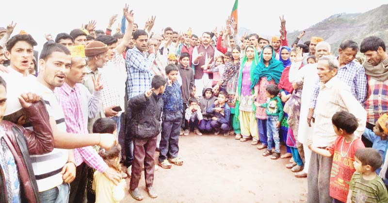 BJP leader R S Pathania with people in Ramnagar.