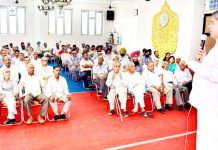 SOS International Chairman, Rajiv Chuni addressing PoK DPs in Jammu on Sunday. -Excelsior/Rakesh