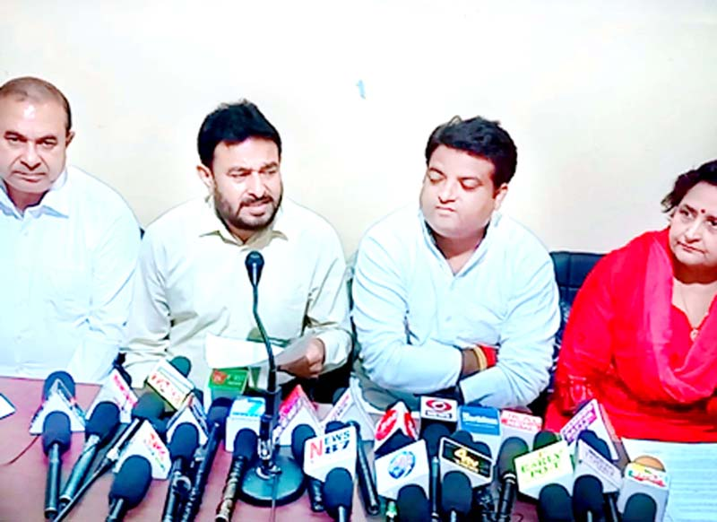 Former minister and Cong leader Ch Gharu Ram addressing press conference in Jammu on Sunday.