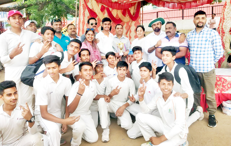 Winners Gandhi Nagar zone boys posing for a group photograph after receiving title trophy from Joint Director DYSS, Madan Lal at Parade ground in Jammu.