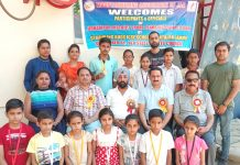 Winners of District Udhampur Sport Climbing meet posing alonwith chief guest at Sprawling Buds ICSE School Bantalab in Jammu on Sunday.