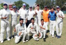 Players of triumphant Rangers United Cricket Club posing along with officials at GGM Science College in Jammu.