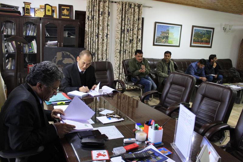 Advisor Khurshid A Ganai chairing a meeting in Srinagar on Monday.