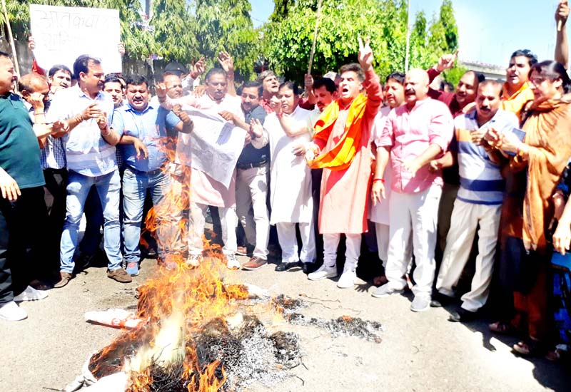 BJP leaders protesting in front of Press Club Jammu on Monday.