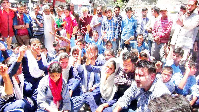 Students raising slogans during protest at Ramban on Monday. -Excelsior/Parvaiz