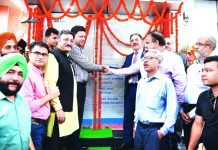 Divisional Commissioner Jammu Sanjeev Verma inaugurating JK Bank's CRM at Press Club Jammu on Friday.