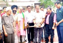 Mayor JMC Chander Mohan Gupta and others kick starting work at Shastri Nagar cremation ground on Friday.