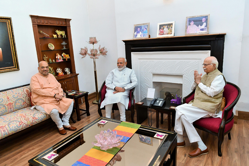 Prime Minister Narendra Modi and BJP president Amit Shah blessed by L K Advani after party's historical victory in general election 2019, in New Delhi on Friday. (UNI)