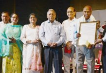 Veteran Dogri writer Narsingh Dev Jamwal being presented Dinu Bhai Pant Memorial Award on Friday.