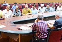 Advisor K K Sharma chairing a meeting in Jammu on Friday.